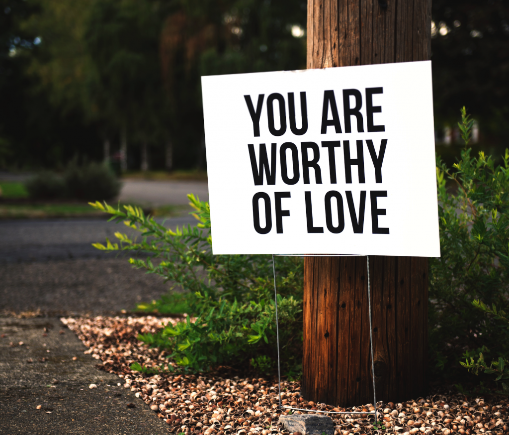 Worthy of love sign post