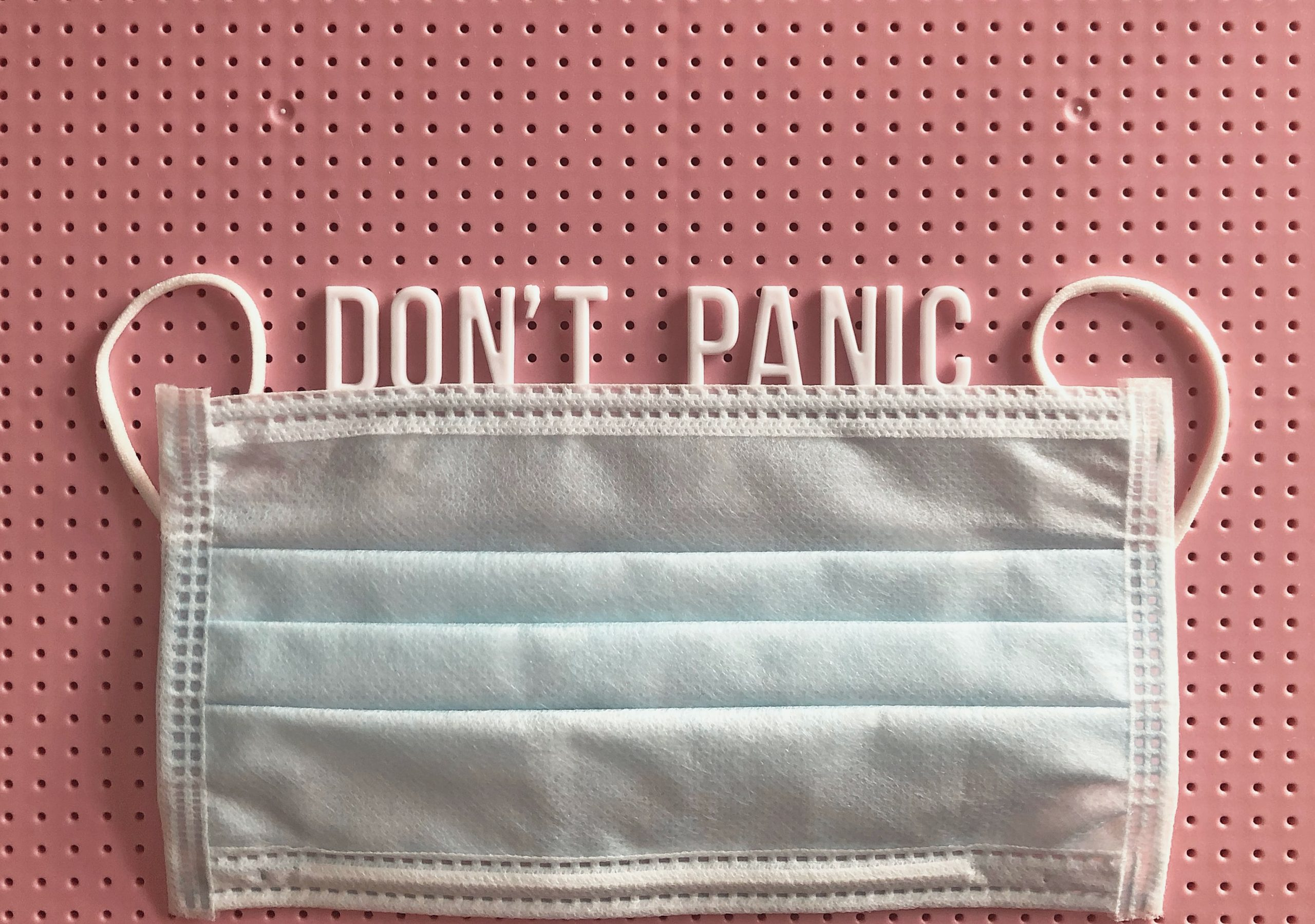 Mask with don't panic sign